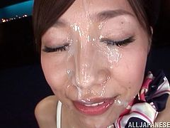 Slutty Japanese chick Miki Horiuhi wearing fishnet pantyhose is having fun with some guy indoors. She rubs the man's schlong with her feet and feels glad to get loads of cum on her face.
