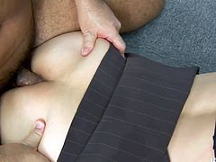 Arousing Japanese cutie in strict office wear lies on her belly on the floor while her rapacious colleague anal fucks her in doggy and missionary styles.