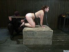 Check out this super hot bondage scene with a redhead slut that gets bound and gagged and her nipples tortured. It's fucking great!