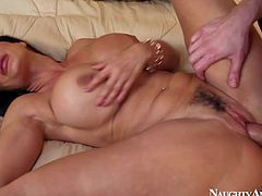Dark haired and aroused pornstar milf Lisa Ann enjoys in getting her shaved and trimmed slit rammed and pounded hard by her lover Danny Wylde on the bed in bedroom
