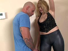 Katie Summers is a naughty good looking blonde milf dressed in black. She gives mouth job to horny man and then gets her shaved pussy and sweet ass licked on the floor. Shes a hot lady!