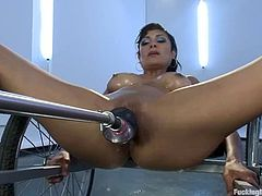Horny brunette girl undresses and massaged her nice titties. After that she gets her vagina toyed hared by the fucking machine.