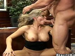Gorgeous blonde milf Ana Nova pleases some guy with a nice blowjob and turns him on. Then she leans against a desk and lets the man to pound her coochie and butt as hard as he can.