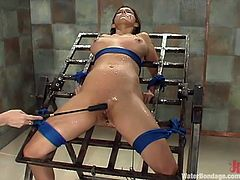 Beautiful slim girl Sasha Monet is playing wet games with her lesbian GF. The dominatrix binds Sasha and plays with her awesome smooth pussy.
