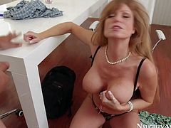Busty and arousing brunette secretary Darla Crane enjoys in pleasing her newest and most sexy client Anthony Rosano with a nasty titjob and blowjob in her office
