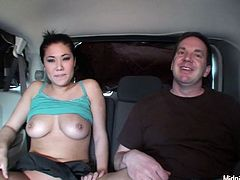 Well, this giggling brunette is actually a voracious slut. Kinky nympho with curvy body seats on the back seat of the car with her BF. Dirty-minded buxom gal takes off her blue top and demonstrates not bad boobs to lure the dude for sex.