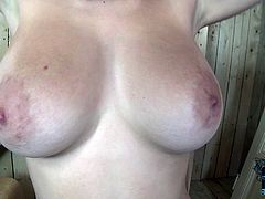 Buxom sexy brunette milf masturbates in the bathroom. But she doesn't only rub her sweet pussy she also twitches her nipples with laundry pin.