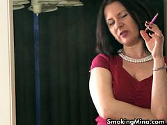 There is something very sexy about chicks smoking cigarettes! Watch this mature whore Mina talking nasty things to make your cock hard!