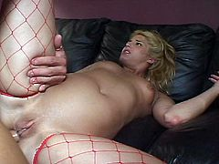 This blonde keeps only her red fishnets on. She spreads her ass cheeks for this guy's cock to enter deep.