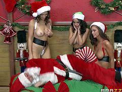 Lili Love, Dillon Harper and Whitney Westgate with tight asses and great hunger for pussy in sexy Christmas uniforms lick each other while James Deen dressed as Santa is watching them
