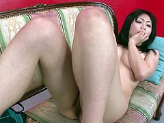 Busty Japanese hoe Nozomi Hazuki fingers intensively her bearded cunt