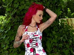 This red-haired enchantress looks very tempting in her retro-style dress that really goes well with her red panties. Then she peels aside her frock and shows us her beautiful body, with nice round tits and well-shaped legs.
