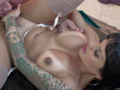 This tattooed dark haired shemale with big tits and small dick gets pleasure in one on one action with horny bald guy. She has a nice time licking her sweet asshole. She loves it.