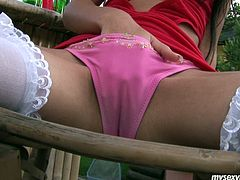 Katja is tempting brunette porn actress having hell seductive appeal. She wears red color mini dress, white nylon stockings and high heels. She fondles her pussy sitting on a bench outdoor. Then she takes big sex toy filling her pussy hole with it. She wanks passionately. Just press play and jack off on this babe.