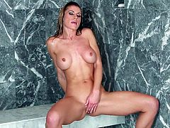 Busty and arousing babe Randy Moore enjoys in playing with her big boobs and her shaved taco under shower during her bath time in front of the camera