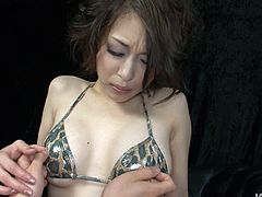 Mind taking Japanese babe in steamy leopard-printed lingerie sits with legs spread aside in front of horny dude who pokes her bearded vagina with fingers in sultry solo sex video by Jav HD.