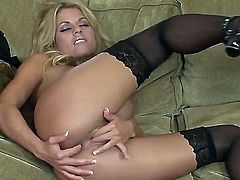 Turned on pretty blonde Nicole Graves with french manicure and big firm hooters in stockings only spreads legs and enjoys fingering her holes simultaneously to warm orgasm in living room.