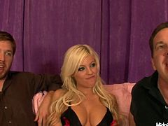 Sexploitress blond bombshell sits between two sex hungry daddies. They arouse her with gentle caressing her shaved cunt before she stands on her knees in front of them to give them steamy blowjob in MMF sex clip by Pornstar.