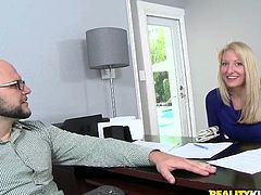 Smiling blondie in tight pants poses on the couch to lure her new boss
