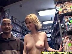 Pale blondie with short hair Alex Devine walks in the sex shop all naked