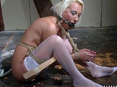 Blonde and horny mature pornstar enjoys in getting all tied up and mouth gagged and dominated by her hunky lover in front of the camera on the floor