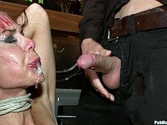 This bitch gets totally abused and humiliated in front of a group of people in this hot bondage scene right here, check it out!