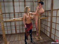 The busty MILF in this video is going to play with a guy, tying him up in different positions and showing him who the boss is.
