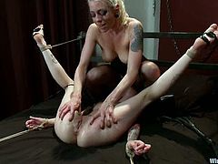 Krysta Kaos gets bound by dominating blonde Lorelei Lee indoors. Lorelei attaches pegs to Krysta's body and then fucks the girl's vag with toys.