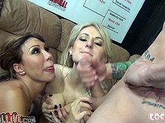 A stunning milf skank with big-ass titties and some gorgeous blonde chick suck on a couple of dicks and do nasty shit here.