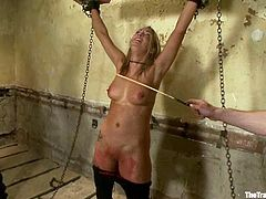 Chained blonde chick sucks a cock and gets whipped. Later on the guy fixes clothespins to her pussy and fuck her.