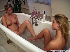 Horn-mad and hot blondie Yasmin stimulates lesbo's cunt with a water stream