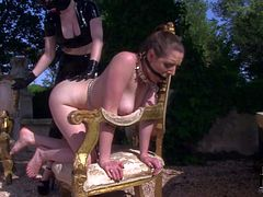 Naked lady Samantha Bentley gets humiliated in the sun by lesbian domina Latex Lucy. Mistress in black latex suit has strap-on dildo to fuck slavegirls mouth under the open sky.