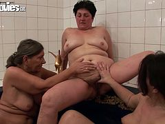 Three kinky momas  play with  tits and pussies in the small pool