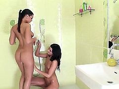 Young turned on Eve Angel with dark heavy make up and natural boobs fingers her tight firm ass while her girlfriend is licking sweet wet honey pot in bathroom.