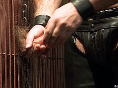 Press play on this gay bondage scene and watch this slave being fucked up his tight asshole by his master after sucking on it.