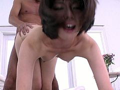 Slender Japanese milf inclines to sturdy cock to suck it zealously before she bends down to welcome a hard fuck from behind in doggy position in sizzling hot sex video by Jav HD.
