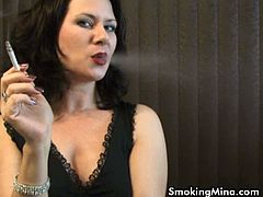 Sexy MILF Mina smokes a cigarette. She enjoys it more than ever and this turns her on and on. She is ready to show you her tight pussy!