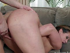 Cock addicted brunette milf Tory Lane with big fake tits and cool tattoo over entire back gives head to young handsome stud Seth Gamble and gets nailed in living room