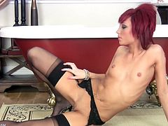 Some hot redhead slut gets naked for the camera and starts fingering her wet snatch in this hot solo sex scene, check it out!