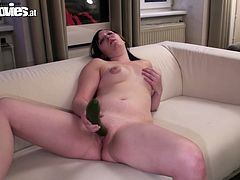 This naughty girl is eager for orgasm and tries to satisfy her pussy. She thrusts cucumber deep in her insatiable pussy and rolls her eyes with pleasure.