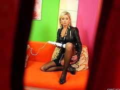 Salty blond hooker sits on the couch in front of a kinky dude wearing a seductive leather outfit and black stockings while he toys her soaking wet pussy with vibrator before she switches to doggy position.