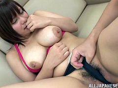 Naughty Japanese girl gets her huge boobs massaged. After that she gives hot blowjob and gets fucked on a sofa.