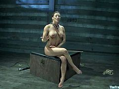 Kinky girl gets tied up in acrobatic position. After that she gets toyed with a vibrator and fucked with a strap-on. Bobbi also gets her pussy fisted.