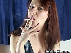 Watch this busty and perverse redhead temptress flaunting her hot body while smoking in this intense vid.