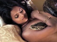 Fuckable Indian cutie with pair of small perky tits gets her cuddly body wrapped by a huge snake who twirls on her pussy, what makes her moans with pleasure.