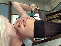 Ashley Fires and Ashley Jane use a strap on to make anal lesbian love