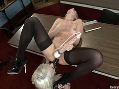 Two sexy blondes Ashley Fires and Ashley Jane are having some good time together. The milf pleases her friend with ass licking and then fucks her butt with a strap on.