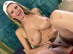 Don't worry, nurse Carol Goldnerova is hear to make your dick as hard as a rock. Watch this blonde milf taking off her outfit and masturbating with a dildo.