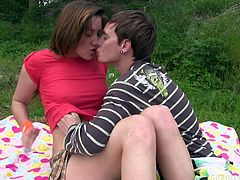 She is pretty teen gal with slim body. She is wearing mini skirt sitting on a grass next to her BF. He slips his hands under the skirt rubbing her pussy while they kiss passionately in a French way.