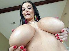 Topless milfyf brunette Ava Addams in panties and shoes is proud of her unthinkably huge melons. She shows off her killer boobs with smile on her face. She loves playing with her oiled up tatas.